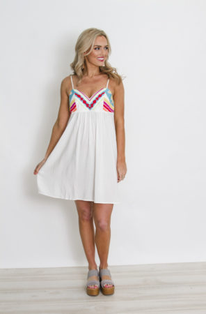 White dress with neon embroidery